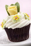 Chocolate cupcake with butter cream and rose Stock Photo