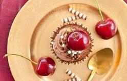 Chocolate cupcake with cherries Royalty Free Stock Photo