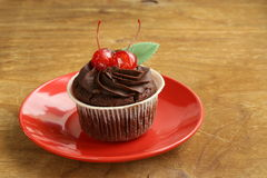 Chocolate Cupcake with cherries and cream Stock Photo