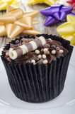 Chocolate cupcake with choco chrunchies. Chocolate cupcake with choco milk roll and chrunchies Stock Images