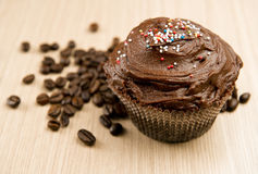 Chocolate cupcake and coffee beans Stock Photos