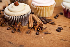 Chocolate cupcake, coffee beans, cinnamon, star anise on sacking Royalty Free Stock Images