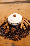 Chocolate cupcake, coffee beans, cinnamon, star anise on sacking Stock Photo