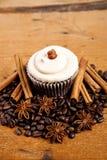 Chocolate cupcake, coffee beans, cinnamon, star anise on sacking Stock Photo