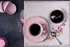 Chocolate cupcake and coffee in pink cup. Top view, copy space. Royalty Free Stock Image