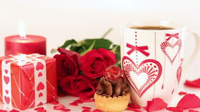 Chocolate cupcake and coffee with roses and gift stock footage