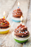 Chocolate cupcake with colorful sprinkles with candles Stock Photography