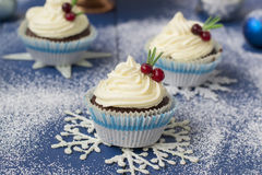 Chocolate cupcake with cream cheese in Christmas decorations.  Royalty Free Stock Photography