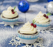 Chocolate cupcake with cream cheese in Christmas decorations.  Royalty Free Stock Photos