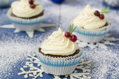Chocolate cupcake with cream cheese in Christmas decorations stock image