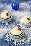 Chocolate cupcake with cream cheese in Christmas decorations.  Stock Photography
