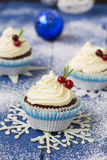 Chocolate cupcake with cream cheese in Christmas decorations.  Stock Photo