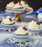 Chocolate cupcake with cream cheese in Christmas decorations.  Royalty Free Stock Images