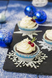 Chocolate cupcake with cream cheese in Christmas decorations.  Stock Image
