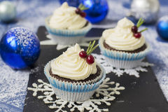 Chocolate cupcake with cream cheese in Christmas decorations.  Stock Images