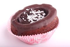 Chocolate cupcake decorated with chocolate frostin Royalty Free Stock Image