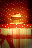 Chocolate cupcake decorated with flowers for gift Royalty Free Stock Photos