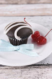 Chocolate cupcake with festive red maraschino cherries - vertical Royalty Free Stock Photography