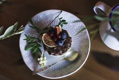 Chocolate cupcake with figs and berries on a wooden table. View. Chocolate cupcake with figs and berries on wooden table. View from top Royalty Free Stock Image