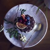 Chocolate cupcake with figs and berries on wooden table. View from top Royalty Free Stock Images