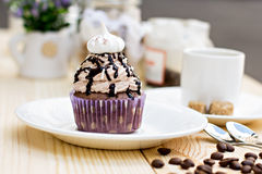 Chocolate Cupcake. With chocolate frosting on the table Stock Photo