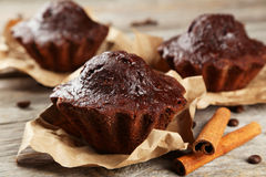 Chocolate cupcake on grey wooden background. Royalty Free Stock Photography