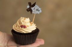 Chocolate cupcake on hand. Sweet chocolate cupcake on hand Royalty Free Stock Images