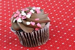 Chocolate Cupcake with Heart Sprinkles Royalty Free Stock Photo