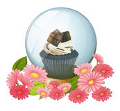 A chocolate cupcake inside the crystal ball Royalty Free Stock Photo