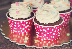 Chocolate cupcake with mousse cream icing on grunge dark wooden background copy space Stock Photo