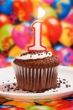 Chocolate Cupcake with a Number One Candle Burning Royalty Free Stock Images