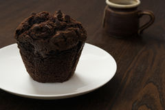 Chocolate cupcake. On a plate royalty free stock image
