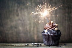 Chocolate cupcake. With a sparkler Royalty Free Stock Photos