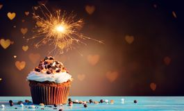 Chocolate Cupcake With Sparkler And Hearts Royalty Free Stock Photo