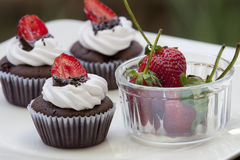 Chocolate Cupcake with strawberry. On White dish royalty free stock photos