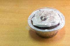 Chocolate cupcake in takeaway cup. Royalty Free Stock Images