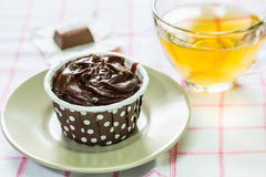 Chocolate cupcake and tea Stock Photos
