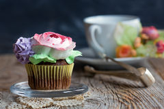 Chocolate cupcake for tea. Royalty Free Stock Photo