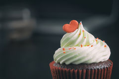 Chocolate Cupcake topped with red heart candy for valentine. Stock Photos