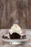 Chocolate Cupcake With Vanilla Frosting Missing Bite On Glass Pl Royalty Free Stock Photography