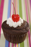 Chocolate Cupcake with Vanilla Icing and Cherry Royalty Free Stock Photography