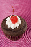 Chocolate Cupcake with Vanilla Icing and Cherry Royalty Free Stock Images