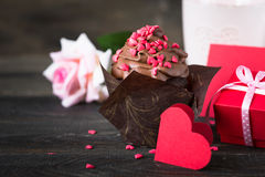 Chocolate cupcake with whipped cream for Valentine`s Day Stock Photos