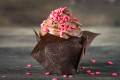 Chocolate cupcake with whipped cream for Valentine`s Day Stock Images