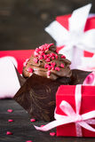 Chocolate cupcake with whipped cream for Valentine`s Day Royalty Free Stock Image