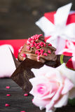 Chocolate cupcake with whipped cream for Valentine`s Day Royalty Free Stock Photography