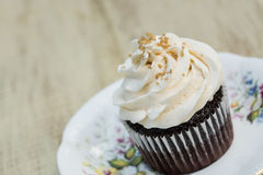 Chocolate Cupcake With White Icing Close Up Royalty Free Stock Photos