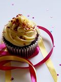 Chocolate Cupcake With White and Red Toppings Stock Photos