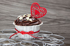 Chocolate cupcake on wooden table Stock Images
