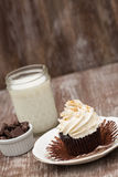 Chocolate Cupcake With Wrapper Peeled and Milk Royalty Free Stock Images